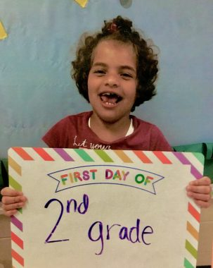 regression \ Angelman Syndrome News \ An older photo shows Juliana smiling on her first day of second grade