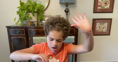 regression \ Angelman Syndrome News \ The author's daughter Juliana, 11, sits at the dining room table with an activity to help her learn colors