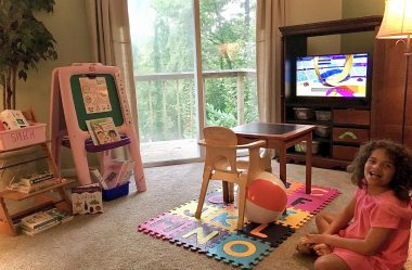 Homework \ Angelman Syndrome News \ Juliana hangs out in her classroom in her dad's home office.
