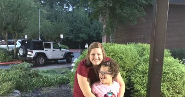 preparing Angelman child for school | Angelman Syndrome News | Juliana smiles as she receives an embrace from her teacher